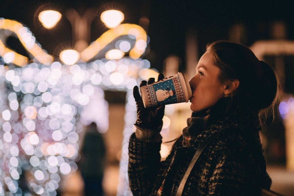 Woman drinking hot chocolate at Christmas time