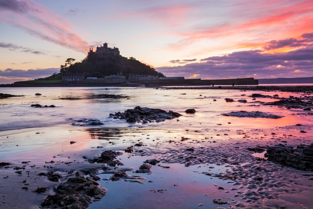 Dramatic sunset on the beach at Marazion with St Michaels Mount in the distance, Cornwall England UK Europe