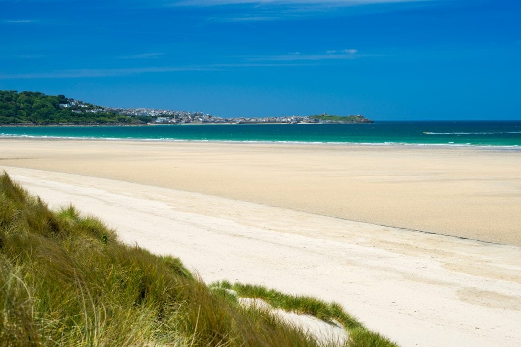 The sand dunes and soft sandy beach on the St Ives to Lelant Walk in Cornwall