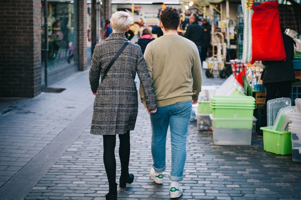 Man and woman holding hands in high-street