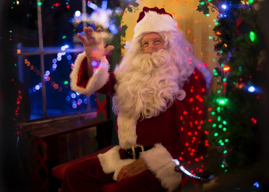 Santa waving in grotto in cornwall
