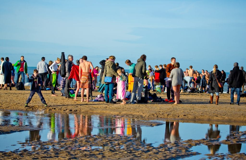 Families huddles together on Cornish beach on Boxing Day