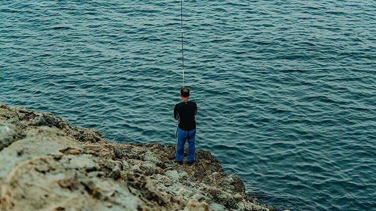 man sea fishing in Cornwall